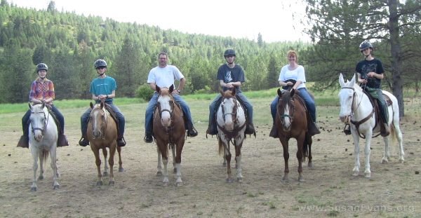 six-people-on-horseback